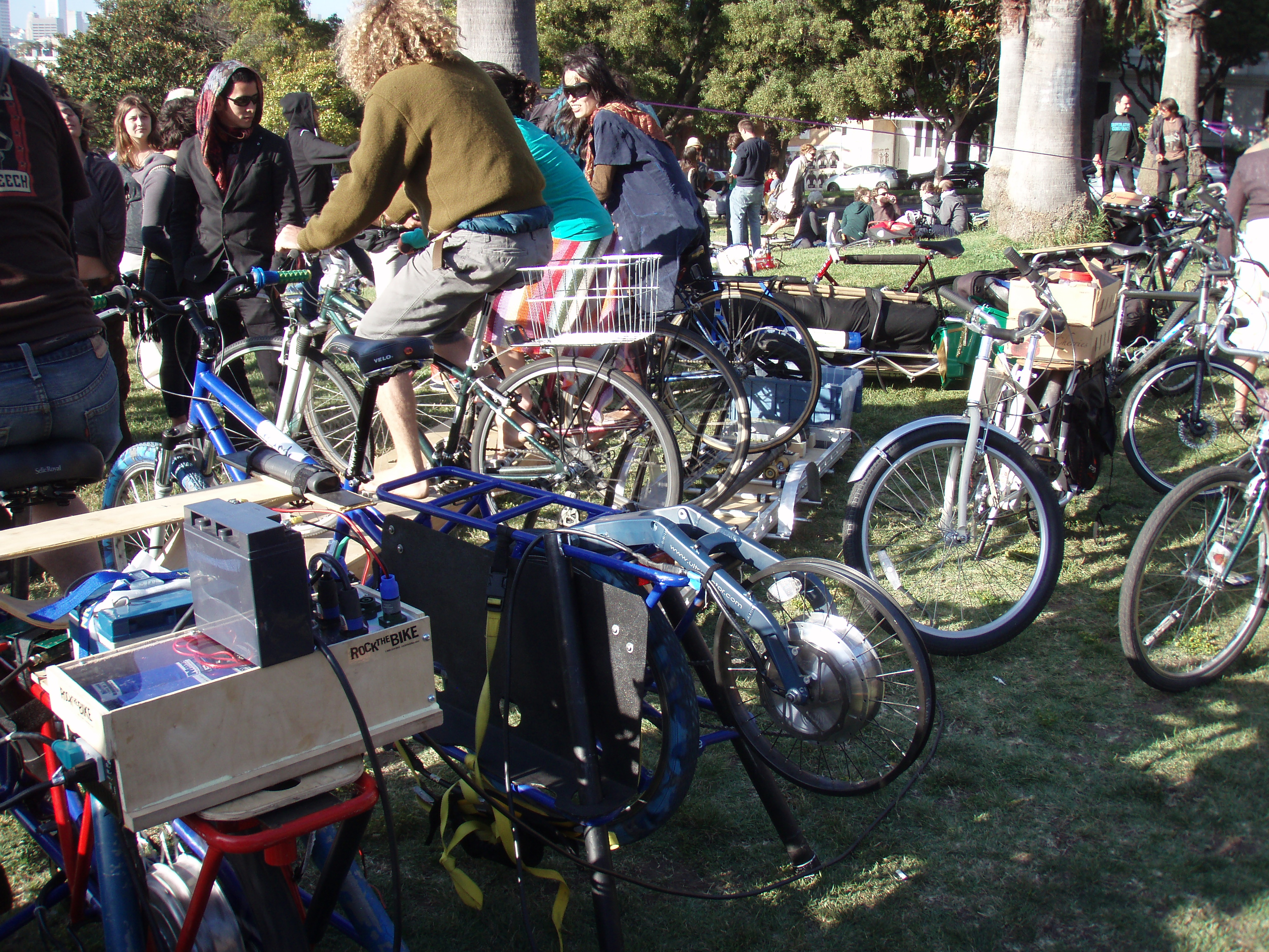 This is the power-generating setup they used.  5 bikes in total, the three far bikes were all connected to the same unit.