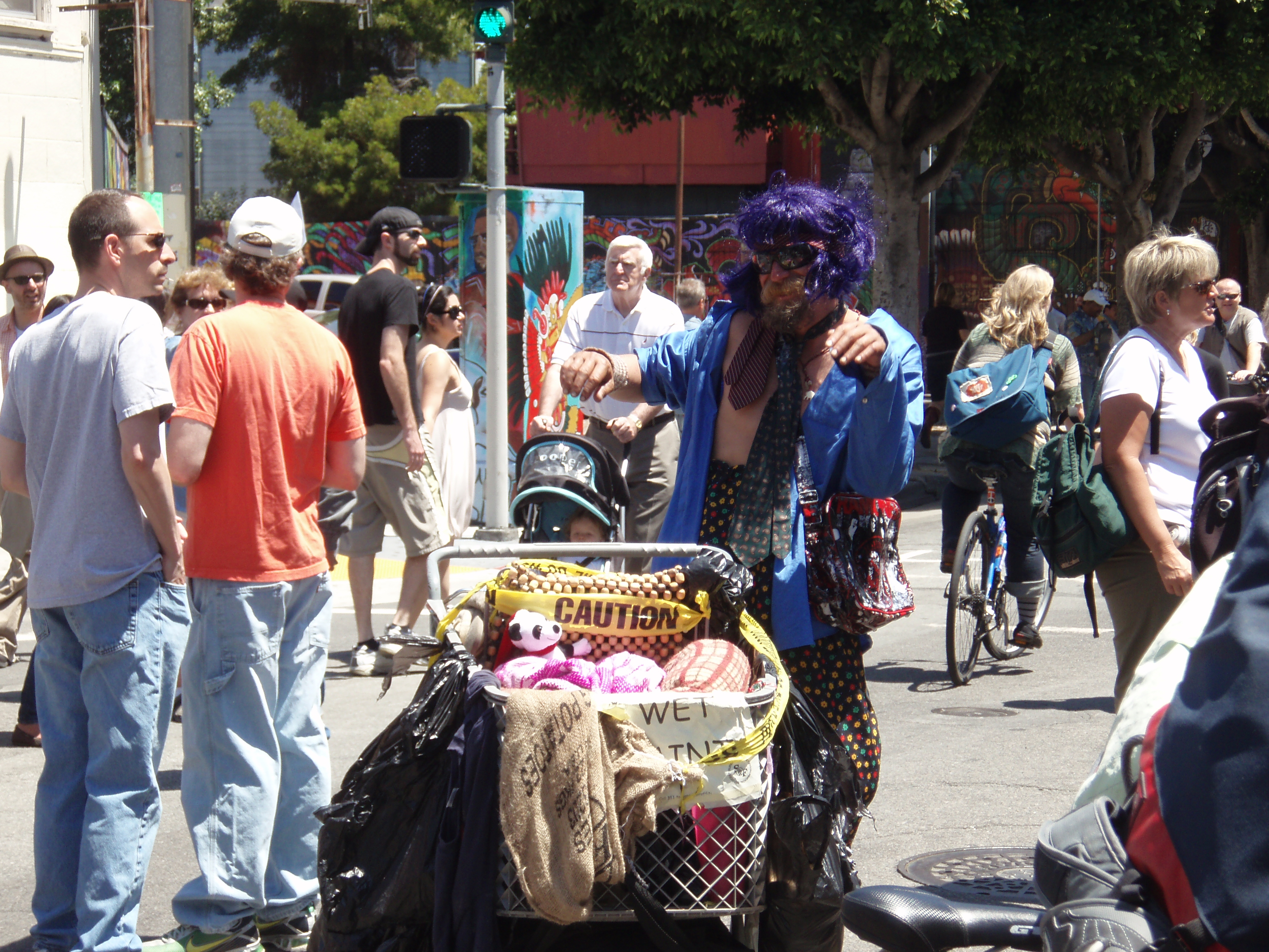 It only took me 3 minutes to find my first scene.  When the Aztec dance demo was going on, this <i>apparently</i> homeless man decided to start breaking it down.  He danced for a solid 5 minutes.  And what an outfit: purple wig, multiple ties, a plastic Rancid purse, high-waisted poka-dot pants, and a hot pair of shades.  He should be on Fashionist.