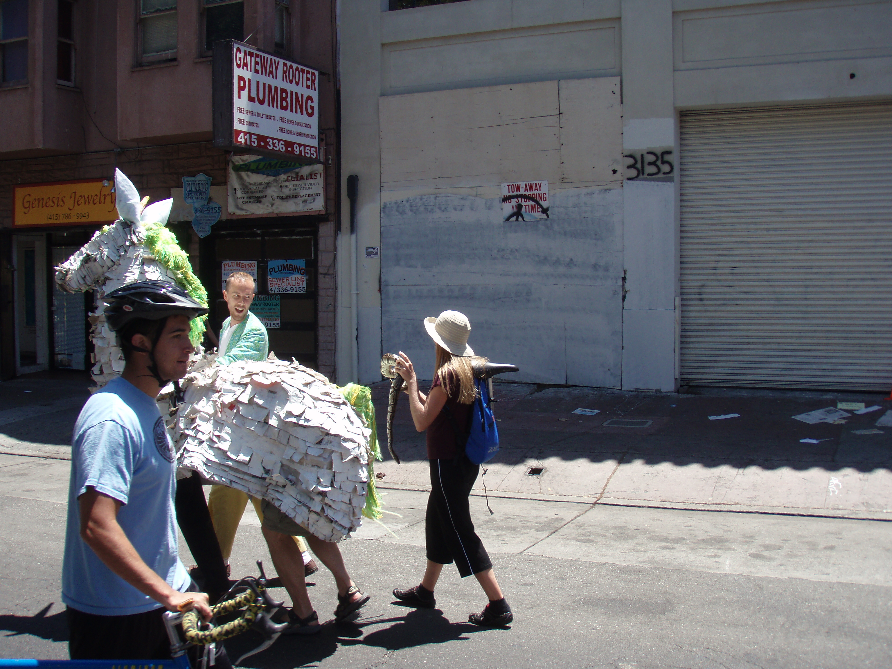 After stopping off at Pop's for a refreshment, I stumbled across a unicorn walking down the street with a crazy lady chasing them with a snake.  I immediately became concerned that the bartender drugged me and I was tripping balls.  After some passersby checked my pupils to confirm my sobriety, I watched in awe as the woman tried to mount the snake on the back of the unicorn, much to the apparent protest of the humans inside the unicorn.