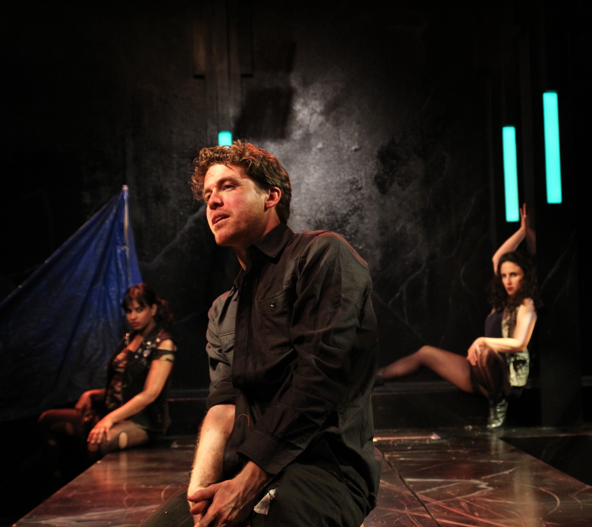 Timon (Brennan Pickman-Thoon, center) laments the power of gold to corrupt while Phynia (Radhika Rao, left) and Timandra (María Ascensión-Leigh, right) look on. Photo by Rob  Melrose